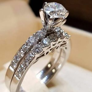 Ladies engagement ring and band silver set